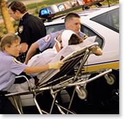 paramedics rushing patient on gurney